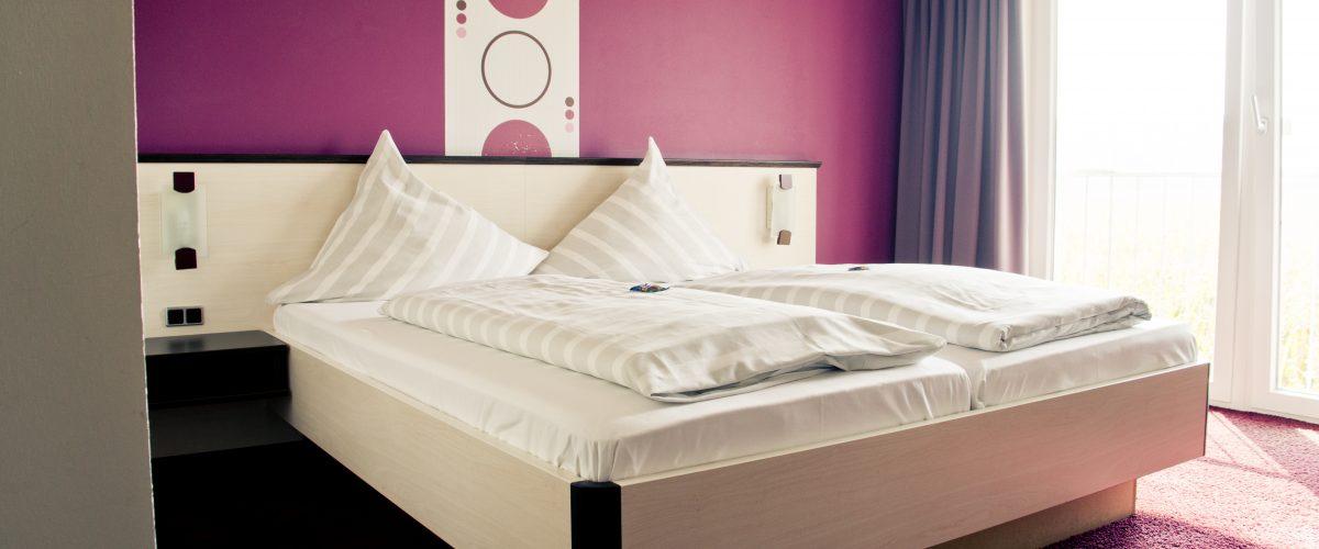 hotel fauna - purple bedroom